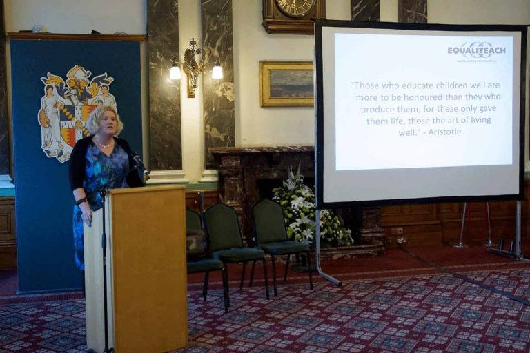 Photo of Sarah Soyei delivering a keynote speech at the launch event of the Universal Values resource