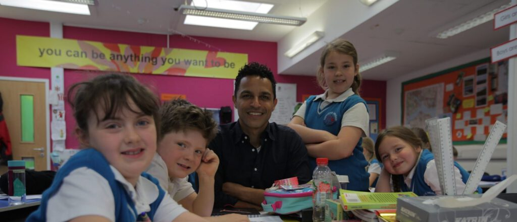 """Dr Javid Abdelmoneim with primary school children from BBC's """"no more boys and girls"""" documentary"""