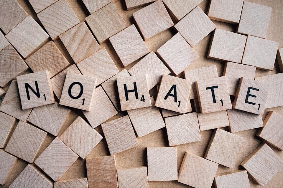 Scrabble pieces spelling 'No Hate'