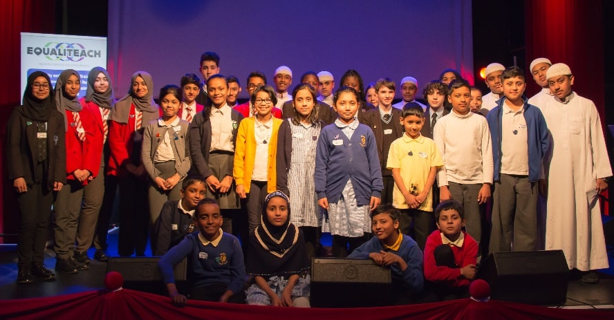 Group of 38 students who took part in the Agents for Change Islamophobia project, on stage