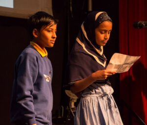 Two primary school students delivering a speech